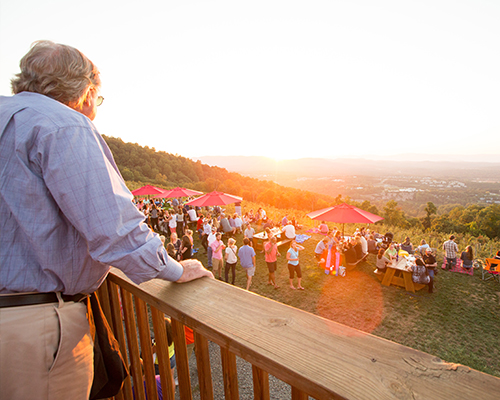 View of Carter Mountain Orchard from the back deck during a live music sunset event