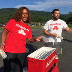 State Farm employees handed out water to thirsty runners