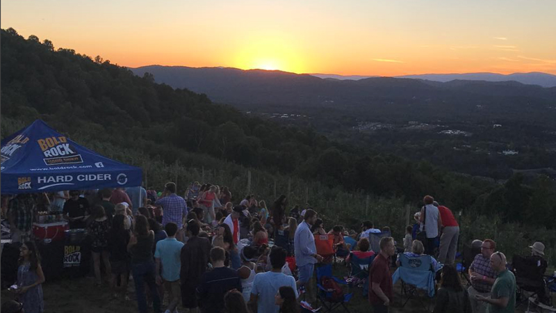 crowd watching the sunset at carter mountain