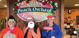 People with Christmas props at Chiles Peach Orchard