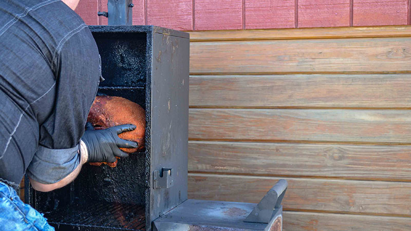 pork barbeque in smoker at Carter Mountain Orchard in Charlottesville