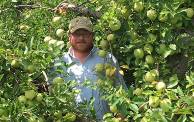 Farmer Henry amongst the apples