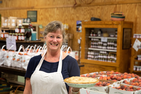 Judy holding a pie