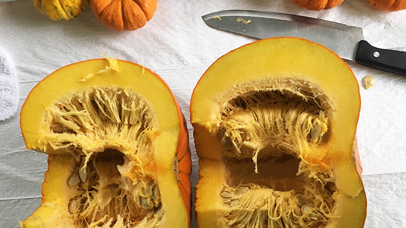 pumpkin cut in half from stem to base