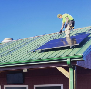 Solar panels being installed at Carter Mountain Orchard's Apple Barn
