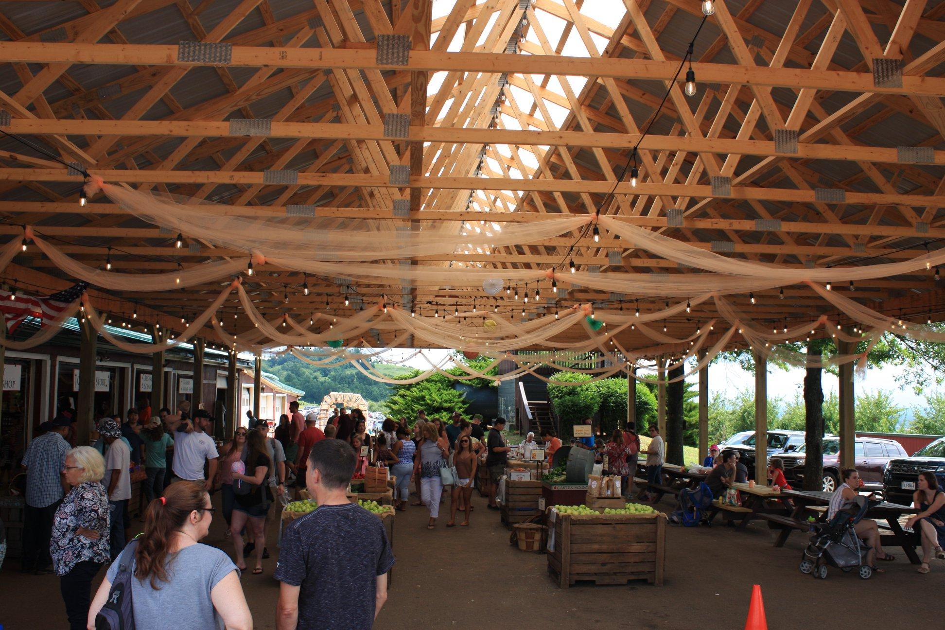 Pavilion covering apple bins and picnic tables at Carter Mountain