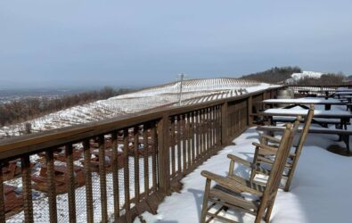 Snow covering the deck and rocking chairs at Carter Mountain Orchard