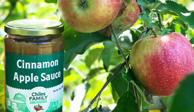 Glass Jar of Cinnamon Apple Sauce by Chiles Family Orchards