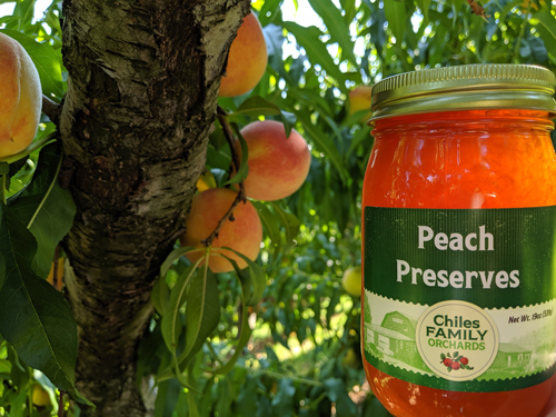 Glass Jar of Peach Preserves by Chiles Family Orchards