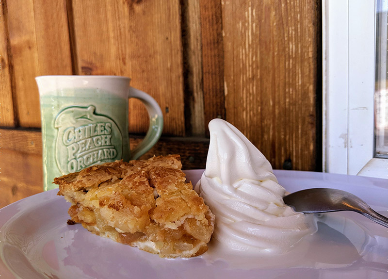 Slice of apple pie and soft-serve ice cream at Chiles Peach Orchard