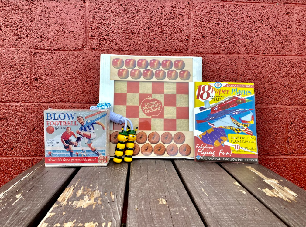 Checkers, blow football, paper planes, and other games from Country Store