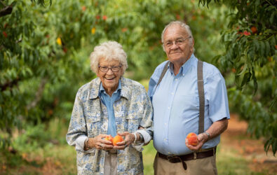 Ruth and Henry Chiles in the orchard