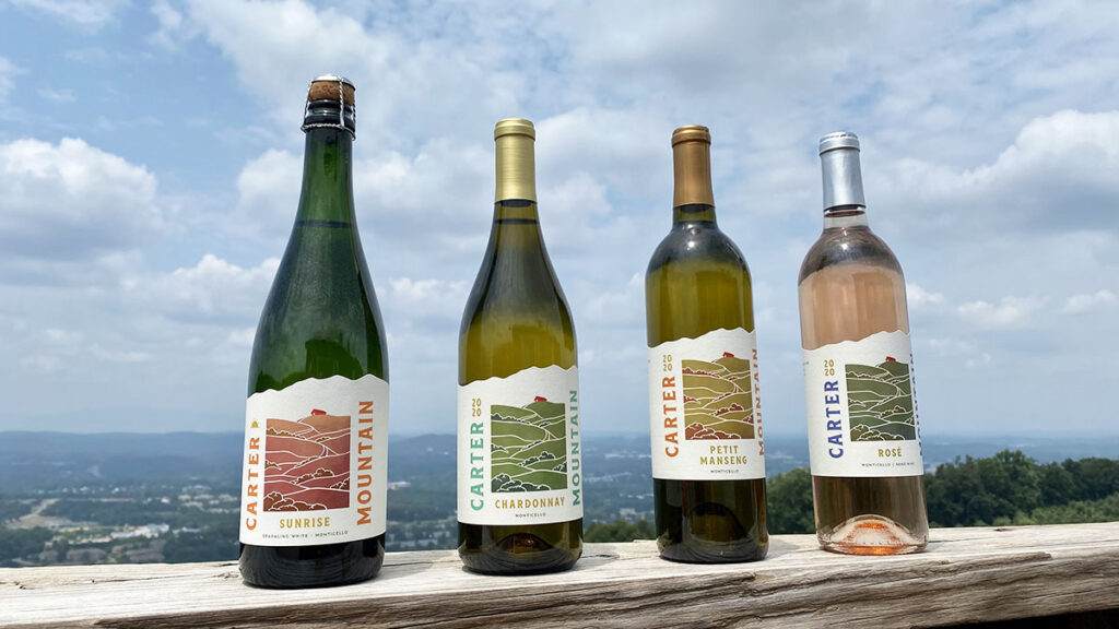 Carter Mountain wine bottles with a scenic view